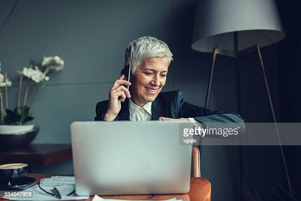 Mature Businesswoman Talking On The Phone.