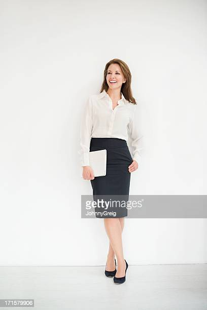 mature businesswoman with digital tablet looking away - formal stock pictures, royalty-free photos & images
