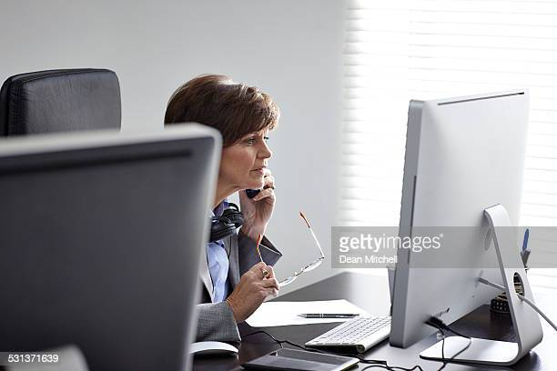 Mature businesswoman working at her desk
