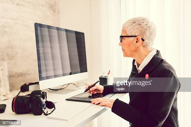 Mature Businesswoman Working In Her Home Office.