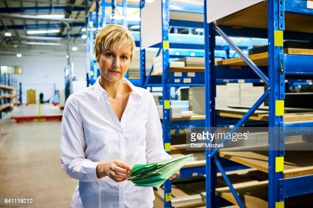 Mature businesswoman working in warehouse