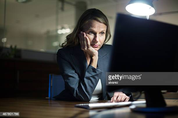 Mature businesswoman working late in office