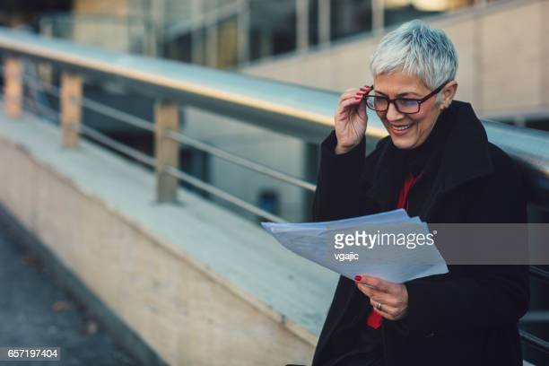 Mature businesswoman working outdoors