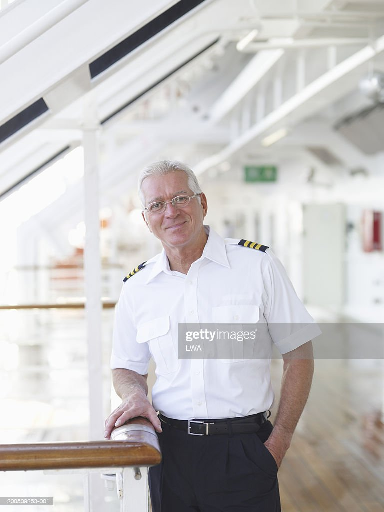 Mature captain on cruise ship, smiling, portrait : Stock Photo