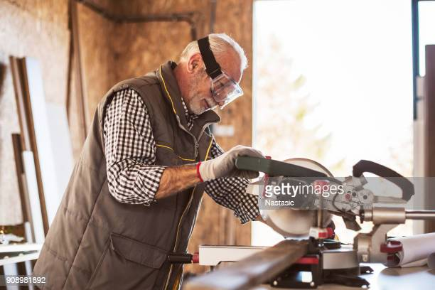 Mature carpenter working on project