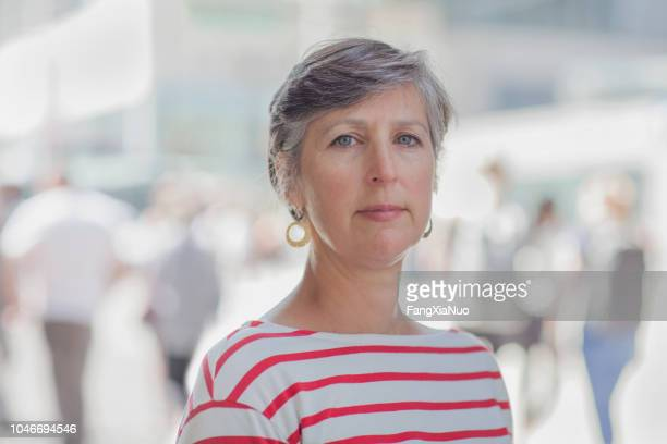 mature caucasian lady street portrait - working seniors stock pictures, royalty-free photos & images