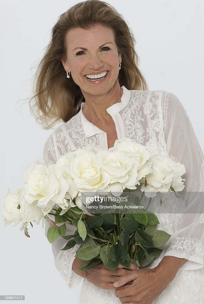 2dfa178d0f21 Mature Caucasian Woman Holding Flowers Stock Photo | Getty Images