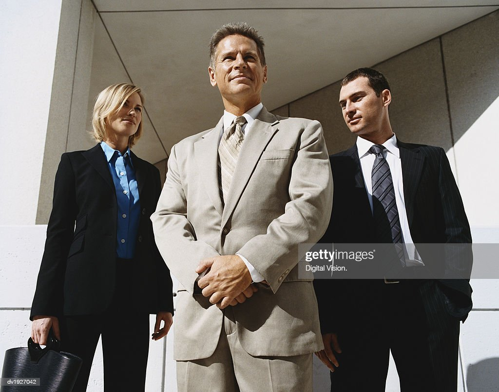 Mature CEO Businessman Outdoors Standing Confident With Male and Female Colleagues : Stock Photo