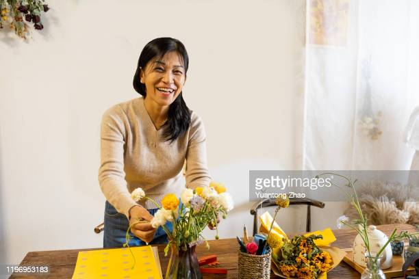 mature chinese woman - showus stock pictures, royalty-free photos & images