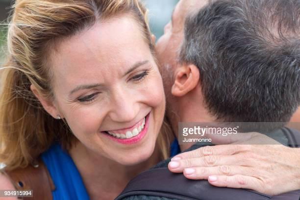 Mature couple ambracing
