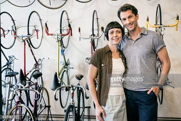 Mature Couple And Owner Of A Bike Store