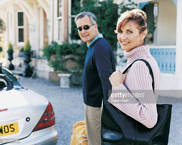 Mature Couple Arriving on Vacation
