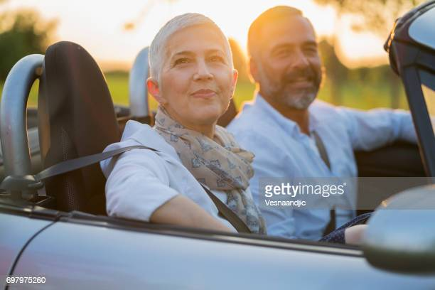 Mature couple at car