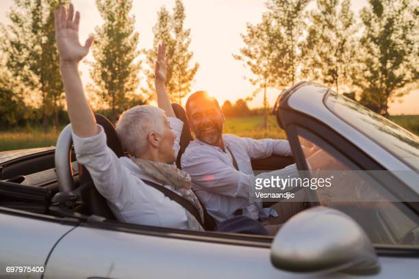 mature couple at car - domestic car stock pictures, royalty-free photos & images