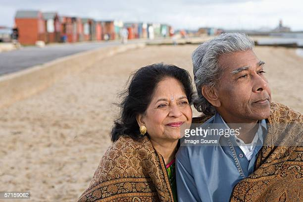 mature couple at the beach - shawl stock pictures, royalty-free photos & images