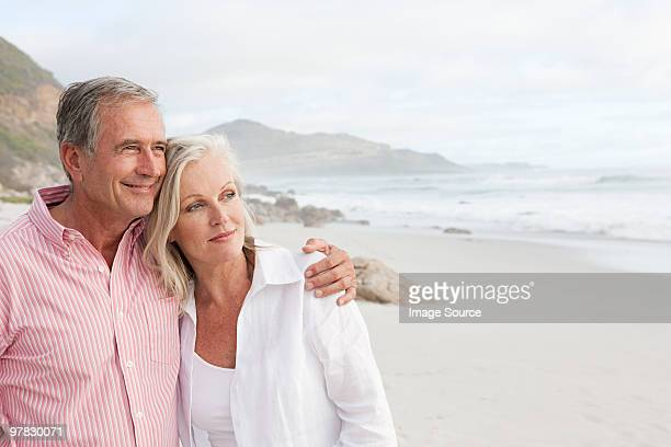 mature couple at the beach - 50 54 years stock pictures, royalty-free photos & images