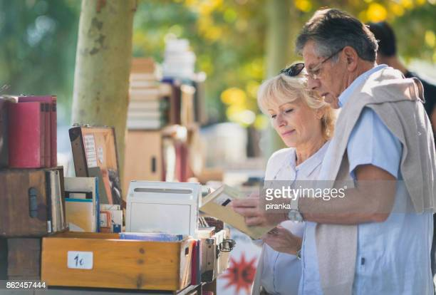 mature couple at the flea market - flea market stock pictures, royalty-free photos & images