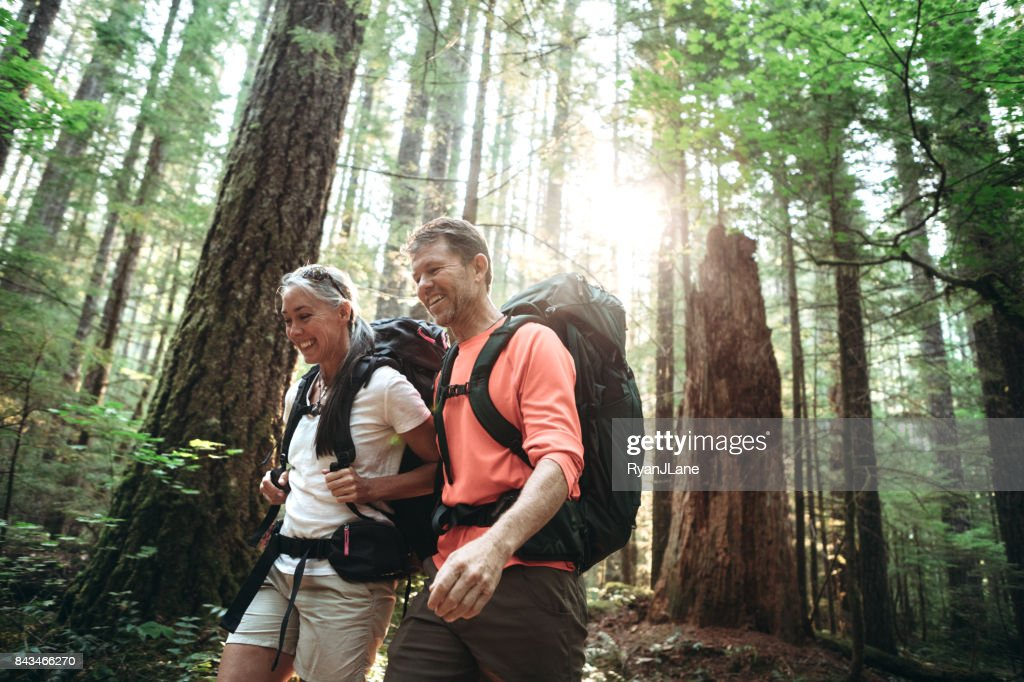 Mature Couple Backpacking in Forest : Stock Photo
