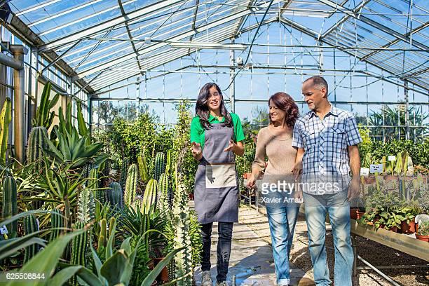 Mature couple buying at garden center