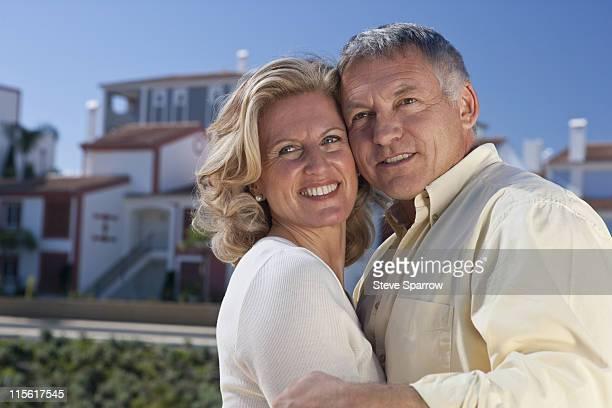 Mature couple by property development