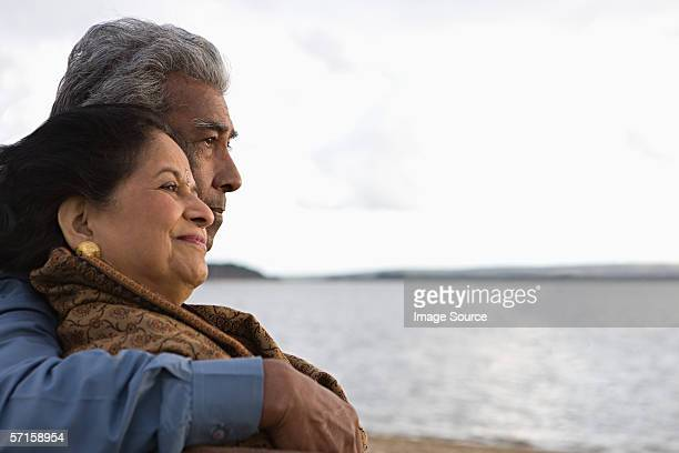mature couple by the sea - indian ethnicity stock pictures, royalty-free photos & images