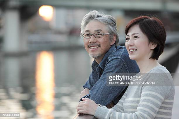 Mature couple by water