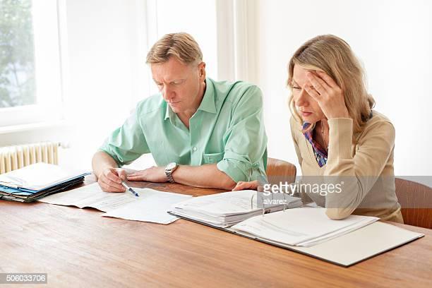 Mature couple calculating home finances