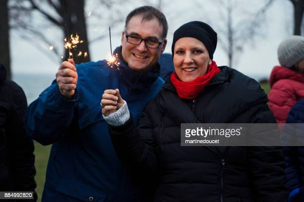 Mature couple celebrating life of cancer patient outdoors winter