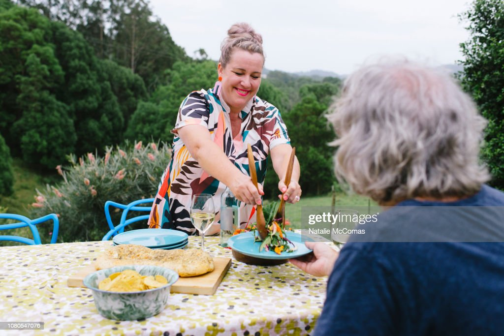 Mature couple celebrating over a dinner on rural property : Stock-Foto