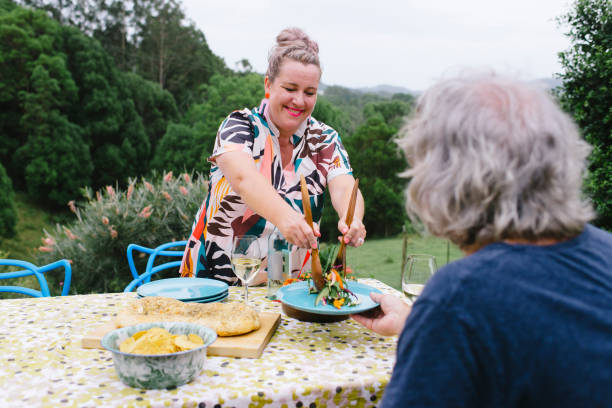Mature couple celebrating over a dinner on rural property
