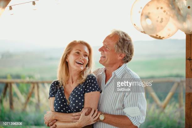 mature couple celebrating - early retirement stock pictures, royalty-free photos & images