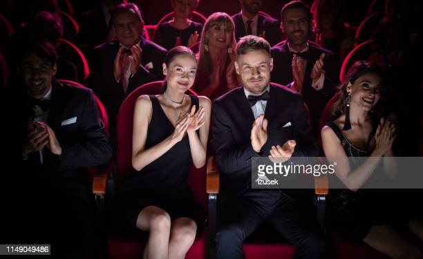 mature couple clapping while watching opera - abbigliamento formale foto e immagini stock