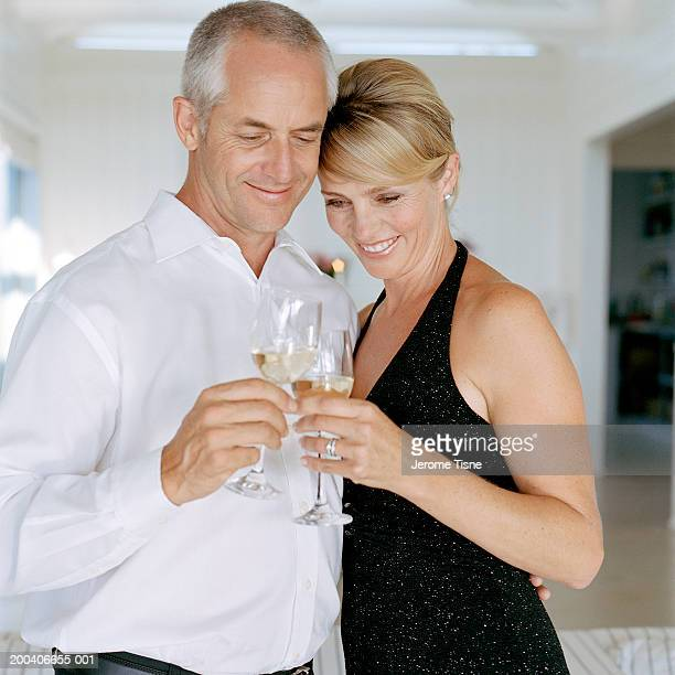 Mature couple clinking champagne flutes
