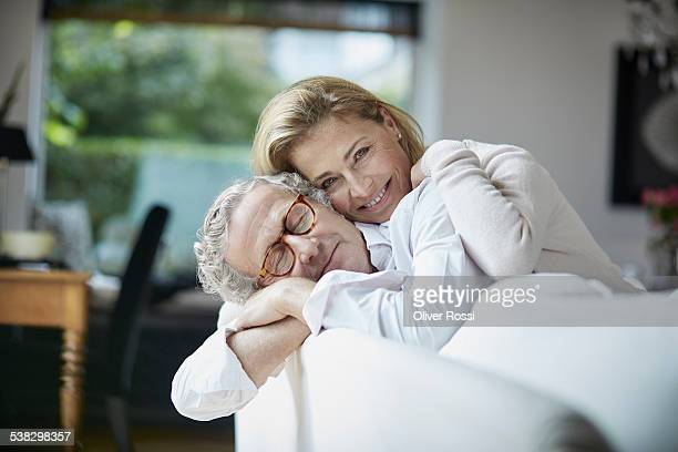Mature couple cuddling at home