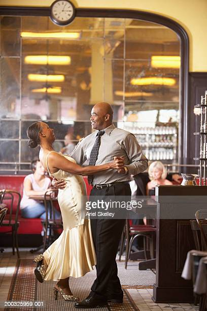 mature couple dancing in restaurant - well dressed stock pictures, royalty-free photos & images