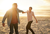 Mature couple dancing on the beach at sunset