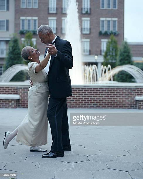 mature couple dancing, outdoors - formal stock pictures, royalty-free photos & images