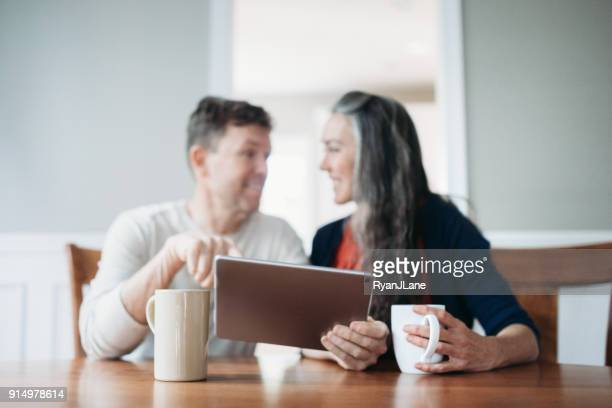 Mature Couple Discussing Finance with Digital Tablet