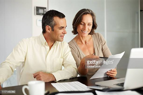 Mature couple discussing house budget