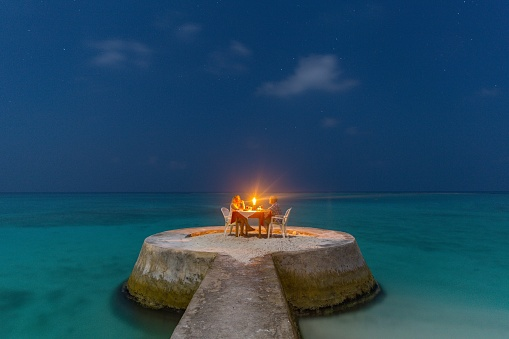 Mature Couple Doing Candlelight Dinner On Pier In Sea - gettyimageskorea