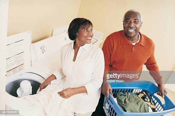 Mature Couple Doing the Laundry