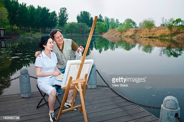 Mature couple drawing