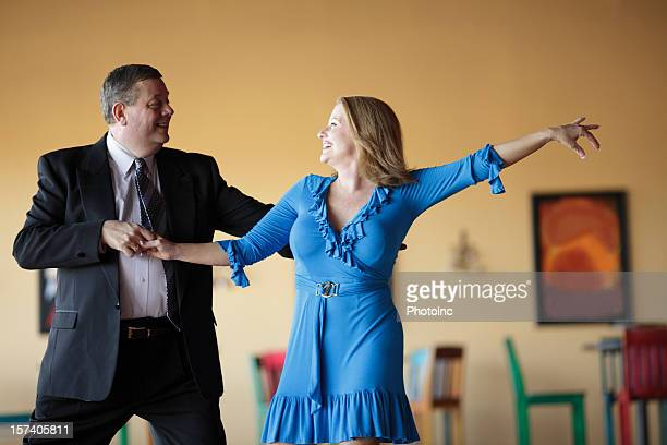 Mature couple dressed in formal attire Ballroom Dancing