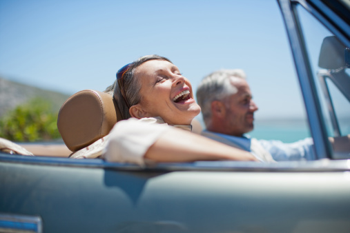 Mature couple driving in convertible - gettyimageskorea
