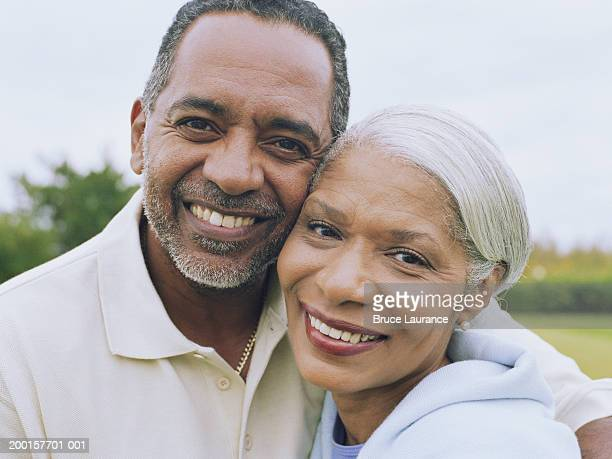 Mature couple embracing, close-up, portrait