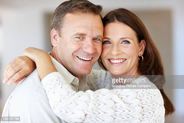 Mature couple embracing each together