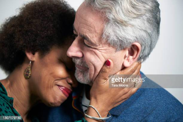 mature couple embracing - embracing stock pictures, royalty-free photos & images