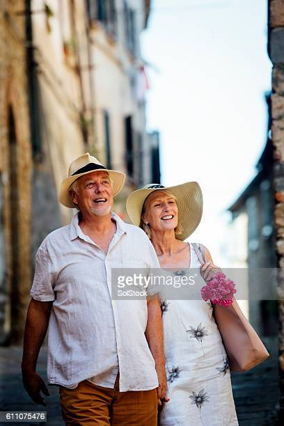 Mature Couple Enjoy Looking Around Old Town Italy