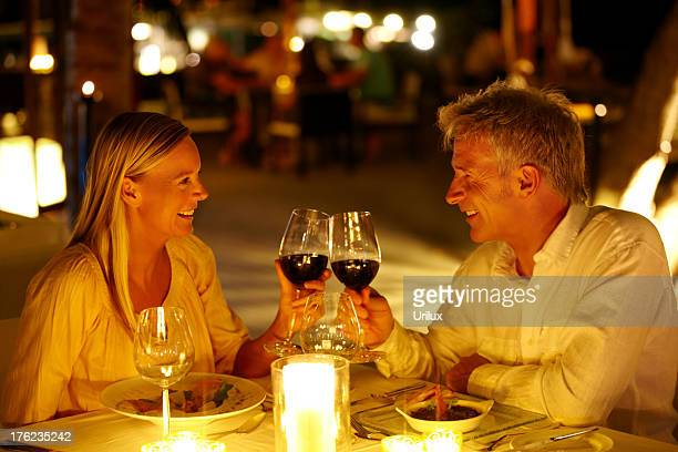 Mature couple enjoying candlelight dinner in a restaurant