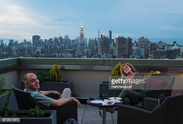 Mature couple enjoying New-York skyline at happy hour.